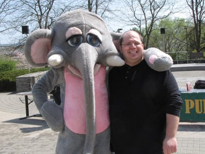 I pose with the elephant man