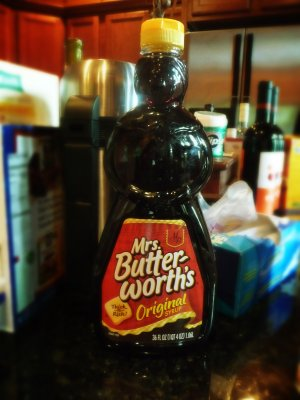 A bottle of Mrs. Butterworth's syrup