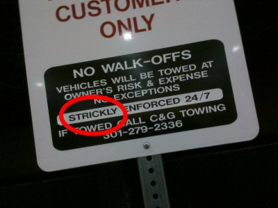 Detail of the sign, with the spelling error circled