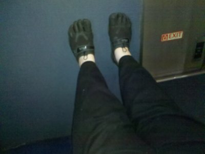 There is, however, a certain benefit to being up in the bulkhead seat. Feet up! Ah, yeah...