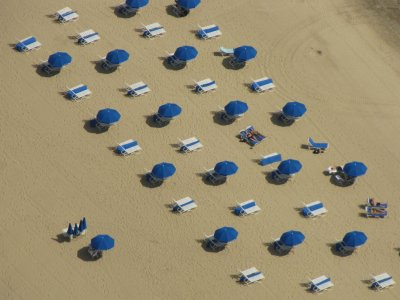 Umbrellas on a lakefront beach