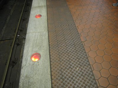 Well-lighted platform edge at Gallery Place lower level.