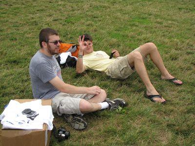 Jon and Jory sit on the grass.