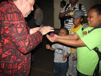 A man performing tricks for the kids
