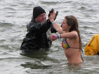 One thing that I saw a lot of at the 3:00 plunge, but not at the earlier plunge, was people going as far out as the line of support personnel in drysuits, and giving them high fives before returning to the beach.