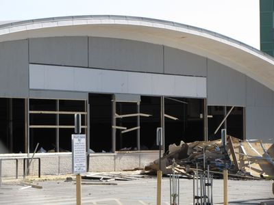 "View from the northwest of the front of the building. The red ""SAFEWAY"" letters were removed when the banner went up in mid 2010. The partial removal of the board-up was done when demolition began. The front of the store was almost entirely glass."