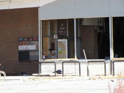 The main entrance to the store. Note the very recent looking exit sign. The board-up is still fully intact on the wall with the entrance on it, and one of the doors is open. I shopped here a few times, but the location was very inconvenient for me, with my living north of the store as I do, which required doing too many turns to get into the parking lot from southbound Georgia Avenue. Thus I probably only went here about five or so times. Maybe the new Safeway store will have better access for drivers coming from the north.