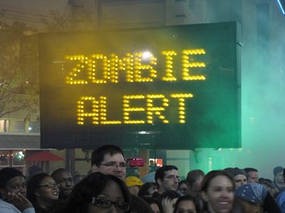 "Normally this would be illegal (like in this case), but this time, they actually set a sign board up and rotated through several messages: ""ZOMBIES!"", ""ZOMBIE ALERT"", ""THIS IS **NOT** A DRILL"", ""UN-DEAD AHEAD"", and ""HIDE YOUR BRAINS"". Classic."