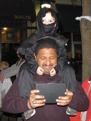 This was adorable, with a child dressing up as a ninja. Meanwhile, the father appears to have found something far more interesting on that BlackBerry tablet than the zombies in front of him.