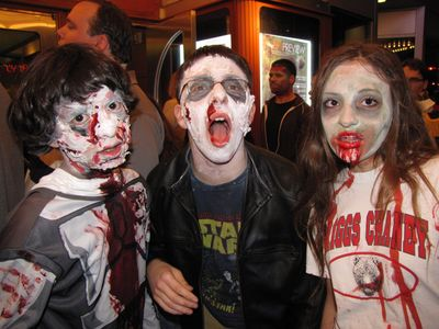 I loved the makeup and blood job on these three, especially the two boys' makeup jobs with the skin-falling-off effect.