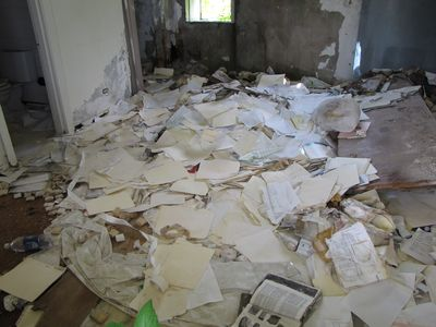 All sorts of paperwork dumped in a former motel room
