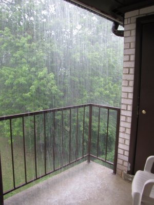 The rain coming off the gutters and down onto the balcony.
