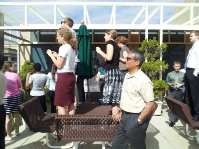 The scene on the roof between passes. Katy and Patton again got a really great view. Genna is behind the green umbrella.