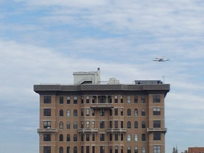 Discovery flies past The Cairo, directly north of our building.
