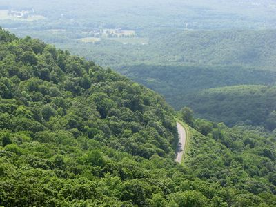 View to the southwest. The road near the center of the photo is the Blue Ridge Parkway, approximately at the elevation where the trail starts.