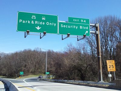 "Final overhead sign assembly on I-70 east. Note the ""END STATE MAINTENANCE"" sign at the exit ramp for Security Boulevard. The final stretch of I-70 is maintained by the Baltimore City Department of Transportation rather than SHA."