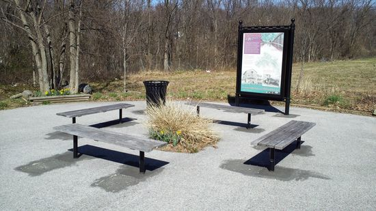Seating area east of the end of the roadway. The Gwynns Falls Trail begins from this location.