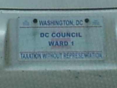 Detail of the first image, showing Jim Graham's special DC Council license plate.