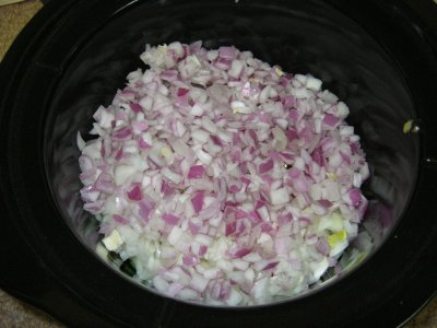 Both containers of onion in the pot.