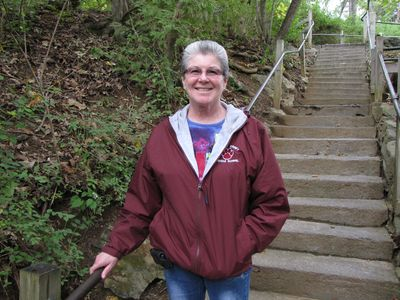 Mom stops for a smile on the stairs down to the Natural Bridge.