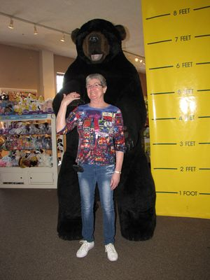 "Mom poses with the bear.  First she made a ""terrified"" pose, and then she did a straight pose with it like I did."