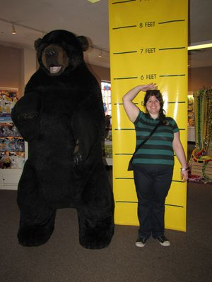 Sis does similarly, first posing with the height measure (the gist of it is to show how tall you were when you visited Natural Bridge), and then acting scared with the bear.