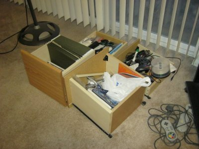 The drawers from the old desk, still full of junk