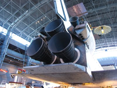 Space Shuttle Main Engines (SSMEs) on Discovery - the real thing.  Note how the SSME nozzles on Discovery have rings on the outside, while the simulated SSME nozzles on Enterprise were smooth.