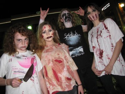 This group had some amazing effects going on.  The girl to the left had words scratched out and changed, the girl next to her had gauze around her mouth, the guy had some pretty awesome makeup, and the girl to the far right had fashioned a grille out of gauze that she wore over her mouth.