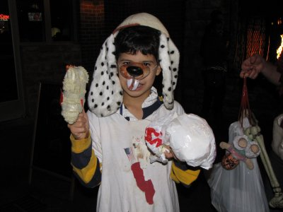 This costume reminded me, in a weird way, of a zombie version of Chuck E. Cheese.  It also reminded me of this picture from a Showbiz Pizza nostalgia group I'm part of on Facebook, showing Billy Bob holding the severed head of Chuck E. Cheese (Concept Unification is still something of a sore spot).  I'm probably reading far too much into this, but it amused me.
