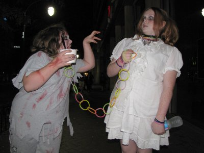 It was rare to find kids south of Ellsworth Drive, but these two kids were there, with their mother.  The zombie on the left was on a glow stick leash, led by the one on the right.  And apparently the zombie on the right is terrified by the one on the left...
