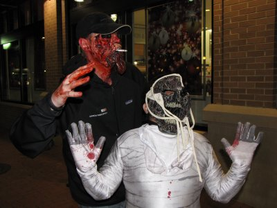"Zombie mummy meets zombie cigarette man.  Could almost see him moaning, ""Nicotine!"" instead of ""Brains!"""