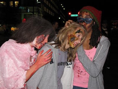 Over by the ice rink, two zombies eating the brain out of another zombie's head.