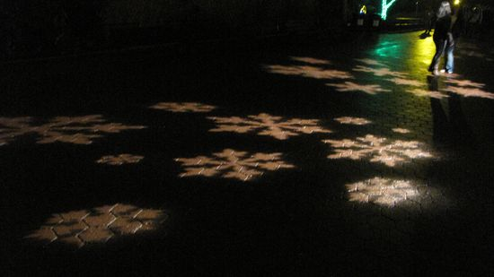 Another thing that was a recurring feature was light shaped like various things projected onto the ground.  Here, snowflakes are projected onto the sidewalk.