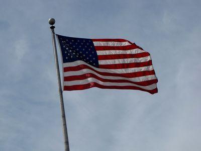 American flag flying near the harbor.