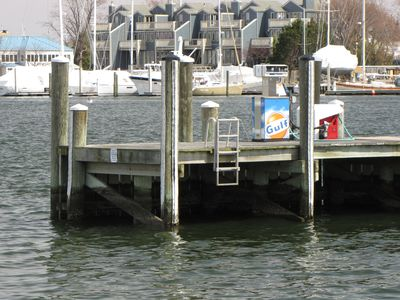 Gas pump on a dock, for fueling boats.