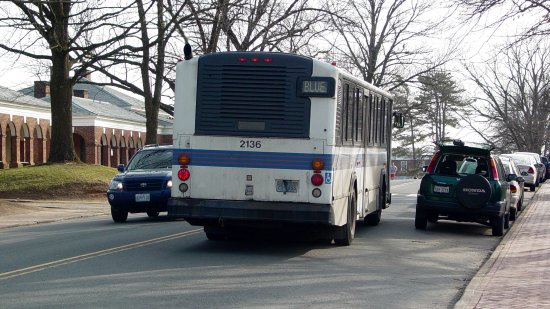 "UTS bus on the UVA campus (pardon me, ""grounds""), passing by a few cars."