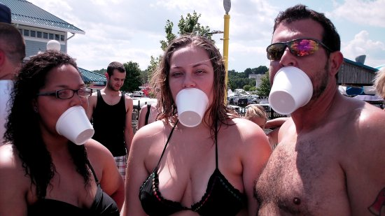 Doreen, Melissa, and Chris hold their cups on their faces using their mouths
