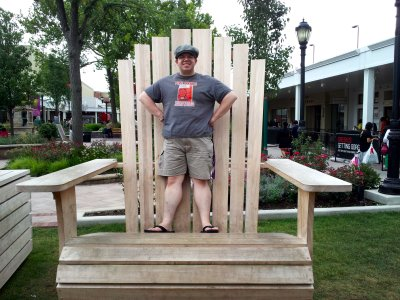 Standing in the giant lawn chair
