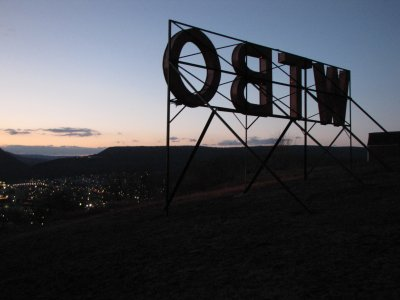 View from behind the sign at sunset, facing the town.