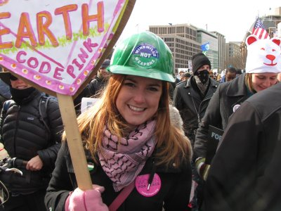 Alli from Code Pink in a hard hat