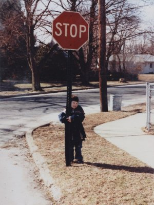 "Posing with the ""falling down stop sign"" in 1983"