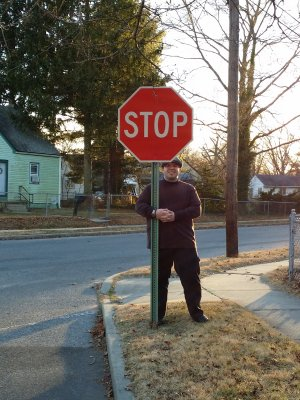 "Posing with the ""falling down stop sign"" in 2013"