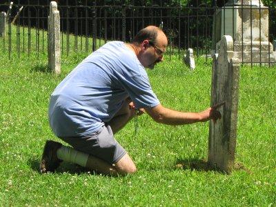 Pete reads a gravestone