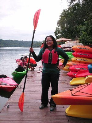 Doreen poses with her paddle after getting out of her kayak.