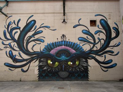 One of the murals that adorns the semi-enclosed part of the Canal Walk (pictured here in 2002). I saw this, and thought it looked like the evil twin of Looney Bird (from The Rock-afire Explosion).