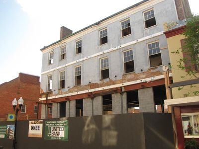 This is the old Taylor Hotel, at 119 North Loudoun Street.  The building is currently undergoing a renovation, which seeks to restore the building to its 1800s appearance, when it contained balconies at the second and third floor levels.