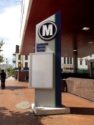 "Sign for Lexington Market on the Metro Subway.  An ""M"" at the top of a sign is something that I'm used to."