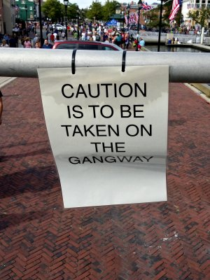 The phrasing of this sign, cable-tied to the gangway railing, struck Elyse and me as being very British.
