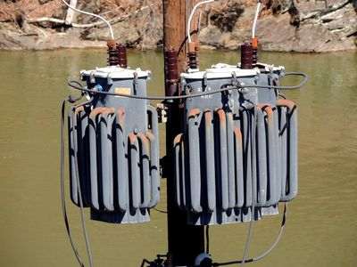 Pole-mounted transformers.